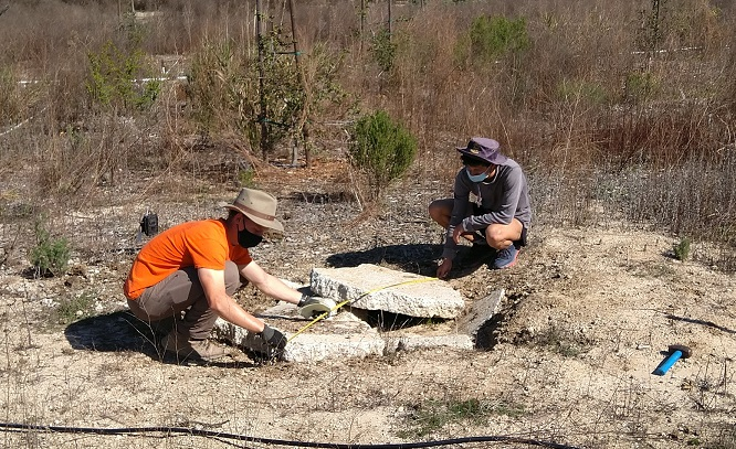 UCSB undergraduate students, Alistair Dobson (left), and Seth Frazer (right), take measurements while setting up motion-detection cameras at hibernaculum at NCOS.